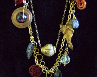 Outrageous brass chains with multiple charms of all materials and shapes