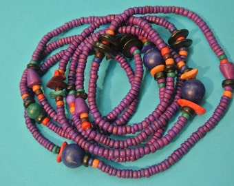 Handmade long vintage 1970s unused purple lilac natural organic coconut wood bead necklace, made in the philliphines
