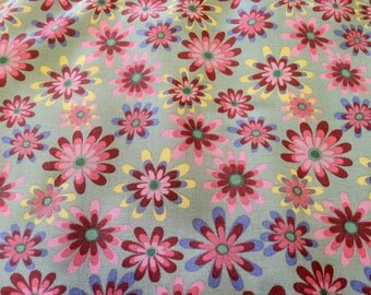 "Flower Power"" print fabric on sage green"