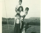 Fun on the Farm Kids Pose For Picture Standing on Bucket Sticks Tongue Out Family Boys Girl Vintage Black and White Photo Photograph