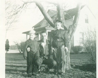 The Greaser Kids 1950s Man Father Standing in Rolled Up Jeans Denim Coat Farm House Tree Vintage Photo Black and White Photograph