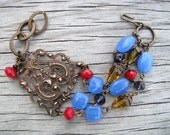 Vintage Trinkets... Blue and Red Beads with Brass Focal Artisan Bracelet
