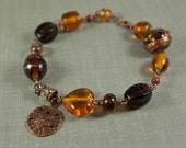 Brown glass and copper sand dollar beaded bracelet