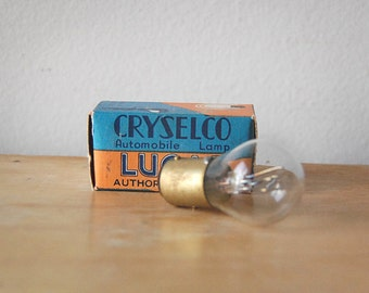 Vintage Auto Miniature Light Electric Bulb in Original Antique Small Box with Orange and Blue Graphic Logo.