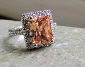 Vintage Sterling Silver Size 6 Beautiful Orange Stone Ring with a Bevy of Surrounding CZ's