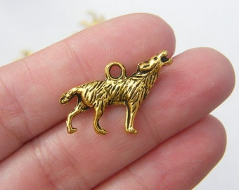 5 Howling wolf charms antique gold tone GC10