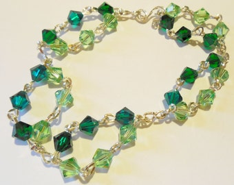 Kelly Green and Sea Green Swarovski Crystals Circling to make a Bracelet