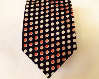 Black neck tie with white and apricot spots