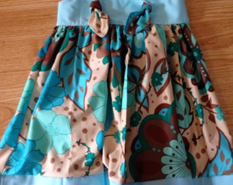 Knot style dress rts size 2t in blues/teals/ and browns. Last of this fabric