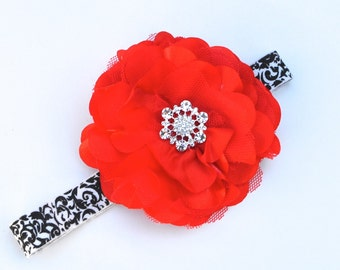 Snowflake jewel red satin flower headband on damask print. Choice of red and black or black and white stretch damask.
