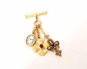 Vintage fleur de lis gold tone vintage pin brooch with dangling charms brooch