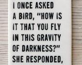 porcelain tag screenprinted text i once asked a bird... -hafiz