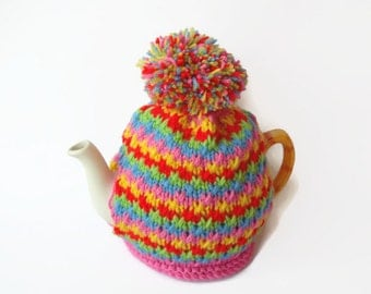 tea cosy cosie hand knitted cozy  rainbow colours  with pom pom