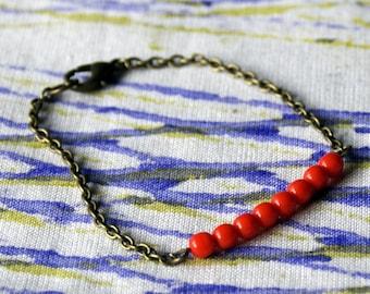 Fine chain bracelet with tangerine beads