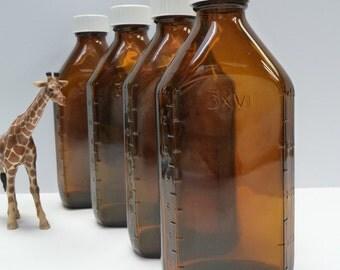 4 Vintage glass Bottles Brown Apothecary Medicine Measurements Lidded jars 16 ounce