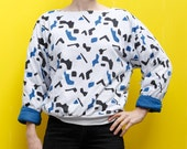 Vintage 80's puffy sweatshirt, white with black & blue confetti pattern - Medium