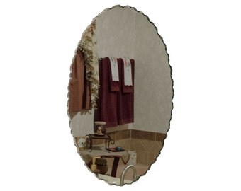 "22"" x 32"" Back Chipped Frameless Oval Wall Mirror"