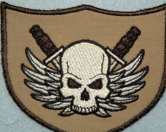 "Winged Skull with Crossed Daggers Shield Iron on Patch 3 7/8"" x 3 1/4"""