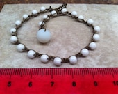Delicate Bracelet White Beaded Pretty With Summer Tan Stack with Other Bracelets Pop of Bright White Color Fun Vacation Beach Arm Candy
