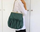 green pleated kisslock bag. green bag. kisslock large bag. pleated bag.