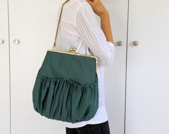 green pleated kisslock bag. green bag. kisslock large bag. pleated bag.