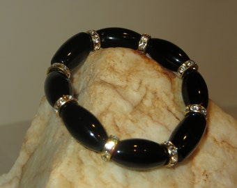 Stretch Black Bead Bracelet with Golden Rhinestone Spacers
