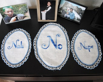 A Chorus of No - hand-stitched on antique, hand-crocheted doilies - Nah, No, Nope