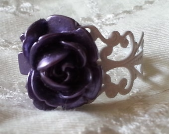Purple rose ring on white filigree ring