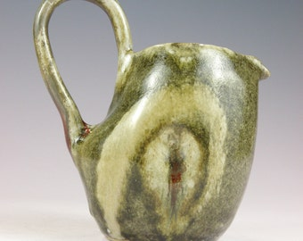 Small Handmade ceramic syrup or dressing pitcher