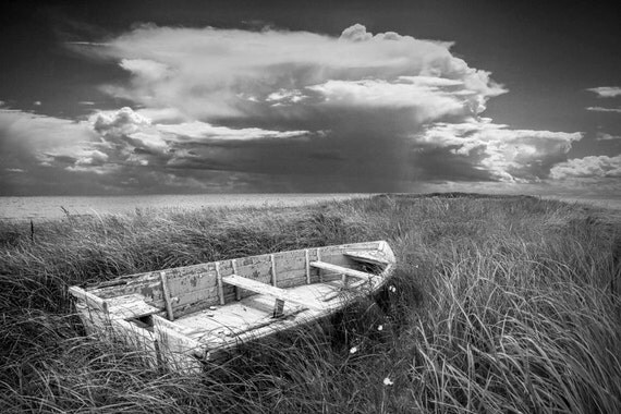 Abandoned Wooden Row Boat on an Ocean Beach Shore on Prince Edward Island Canada No.OLSS A Black and White Fine Art Seascape Boat Photograph