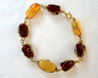 Peaches and cream and garnet red wirer wrapped bracelet