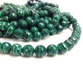 7 mm. AA Grade Malachite Faceted Round Beads 15.5 Inch Strand (MJ0006R15) Reconstituted