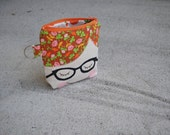 FOR KASHOAN. Doll face pouch. little red head with strawberry guts
