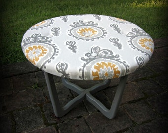 Ikat  Fabric Upholstered Tufted Ottoman