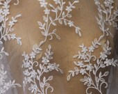 White Lace Tulle Fabric with allover embroidery Flower Petals Design and scalloped  edges on both sides. 50 Inches Wide