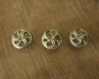 Set of three vintage swirl dresser / cabinet knobs