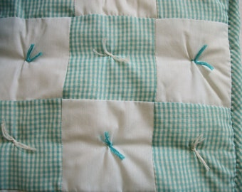 Aqua and white baby quilt with white fleece