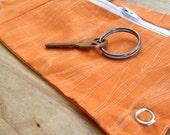 zipper cuff wallet on your wrist, orange faux wood