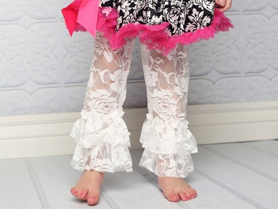 Ruffle Boutique Leggings. With the ruffles and legging right-side out, pin the lace about a half-inch above the ruffles. I don't like to cut my length of lace until I have it completely wrapped around the leg, which has saved me from making so many mistakes.:}.