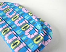 Woman's clutch purse evening bag Modern Aztec abstract print in deep blue, pink, lime yellow and black.