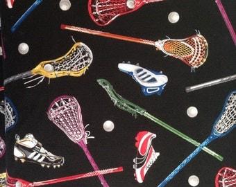 Lacrosse equipment fabric on black background 1  yards  from Elizabeth's Studio