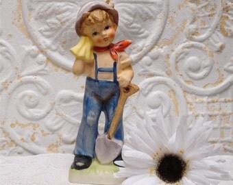 Norleans Boy Figurine Holding Shovel Japan