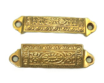 Pair of iron cabinet pulls with gold finish