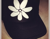 Black trucker with hand painted white Tiare