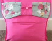 Bright pink cushion cover with a padded bow detail in green floral fabric on fold over flap,pillow sham,throw pillow cover,16x16 inch.