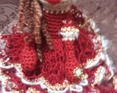 crimson ballgowned yarn doll