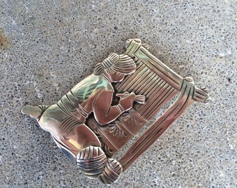 Sterling women weaving brooch signed Perry vintage native