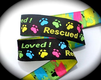 """Woven Jacquard Ribbon 5/8"""" X  2 1/2 YARDS Rescued and Loved in Multi colored paws  Black, Yellow, Pink, Blue and Lime Green"""