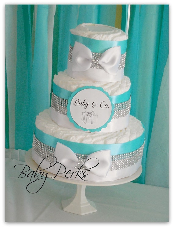 Baby and co diaper cake baby and co baby and co baby by for Baby shower decoration ideas with diapers