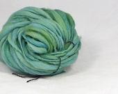 Gum leaf greens  - thick and thin  hand spun, hand dyed yarn. Pure wool slub yarn. Australian 21 micron merino wool.